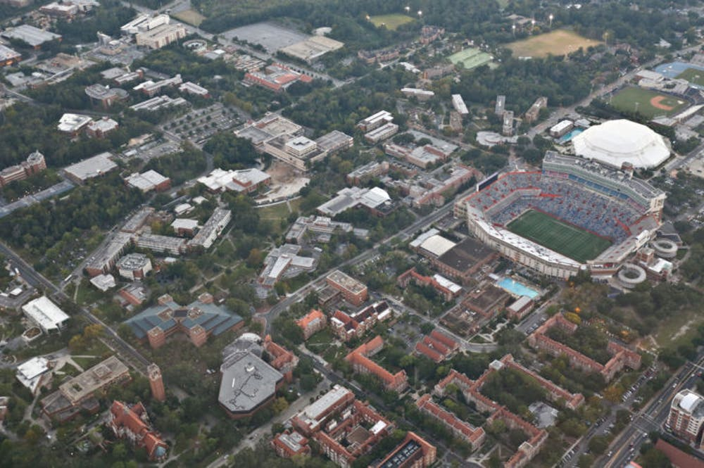 """<p class=""""p1""""><span class=""""s1"""">This shot, taken in October 2013, shows UF's campus from above. On Jan. 6, 1853, state Governor Thomas Brown signed a bill giving public support to higher education.</span></p>"""