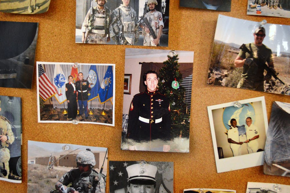 <p><span>Photographs of members in uniform and in the field are displayed on the walls of the Collegiate Veterans Success Center.</span></p>