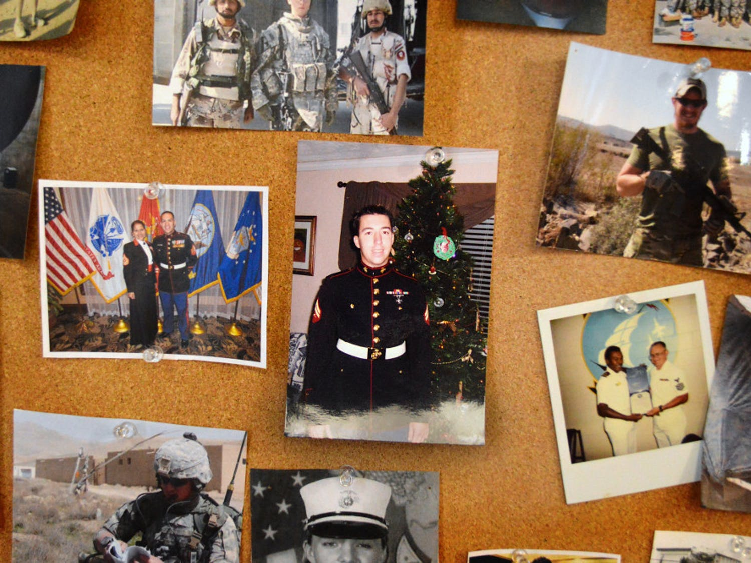 Photographs of members in uniform and in the field are displayed on the walls of the Collegiate Veterans Success Center.