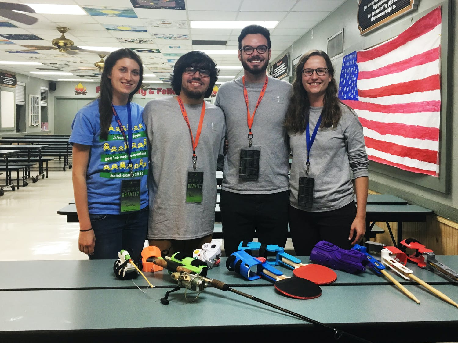 Members of UF GRiP, a club that 3-D prints activity-specific prosthetics, pose with some of their newer models at Hand Camp 2017, a gathering of children with limb differences held from Friday to Sunday in Starke, Florida.
