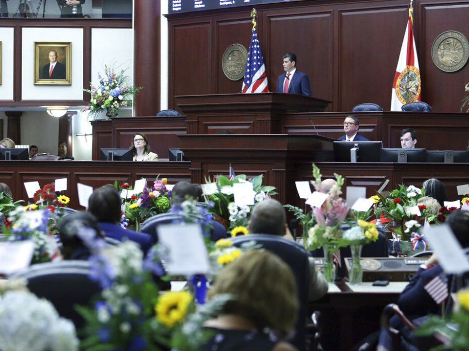Florida House Speaker Jose Oliva, R-Miami Lakes, center, addresses the House at the start of session on Tuesday Jan. 14, 2020, in Tallahassee, Fla. (AP Photo/Steve Cannon)
