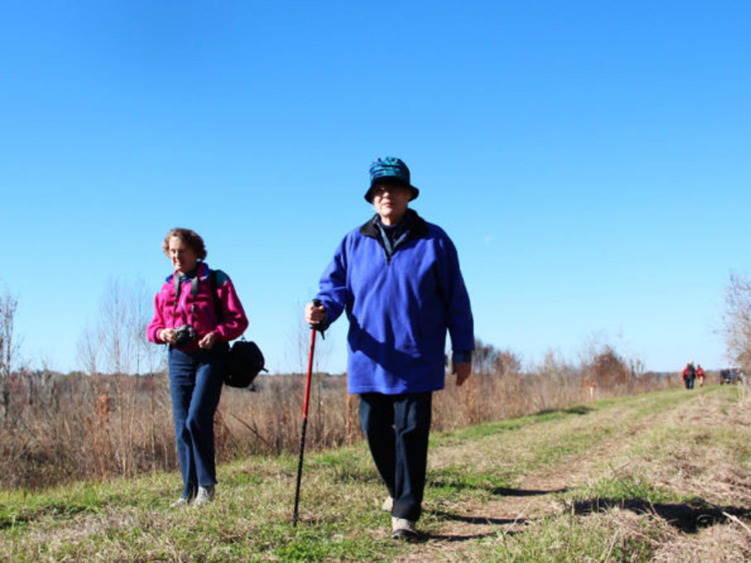 Gainesville resident Mary Horn (right) explores the newly opened Barr Hammock Preserve with Emily Hoon, an Alachua County resident, at the opening celebration Saturday morning. The pair walked along the 6.5-mile Levy Loop hiking trail, which circles around restored marsh.