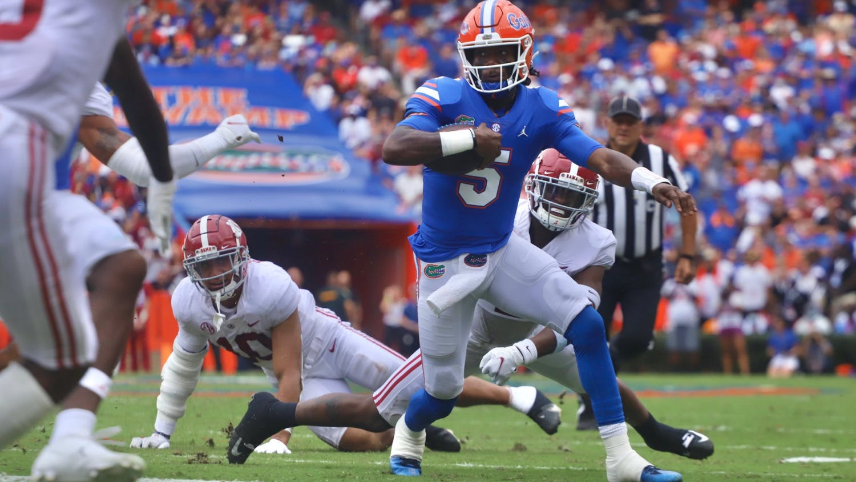 Florida quarterback Emory Jones runs through the Alabama defense in the Gators' 31-29 loss to the Crimson Tide on Sept. 18.