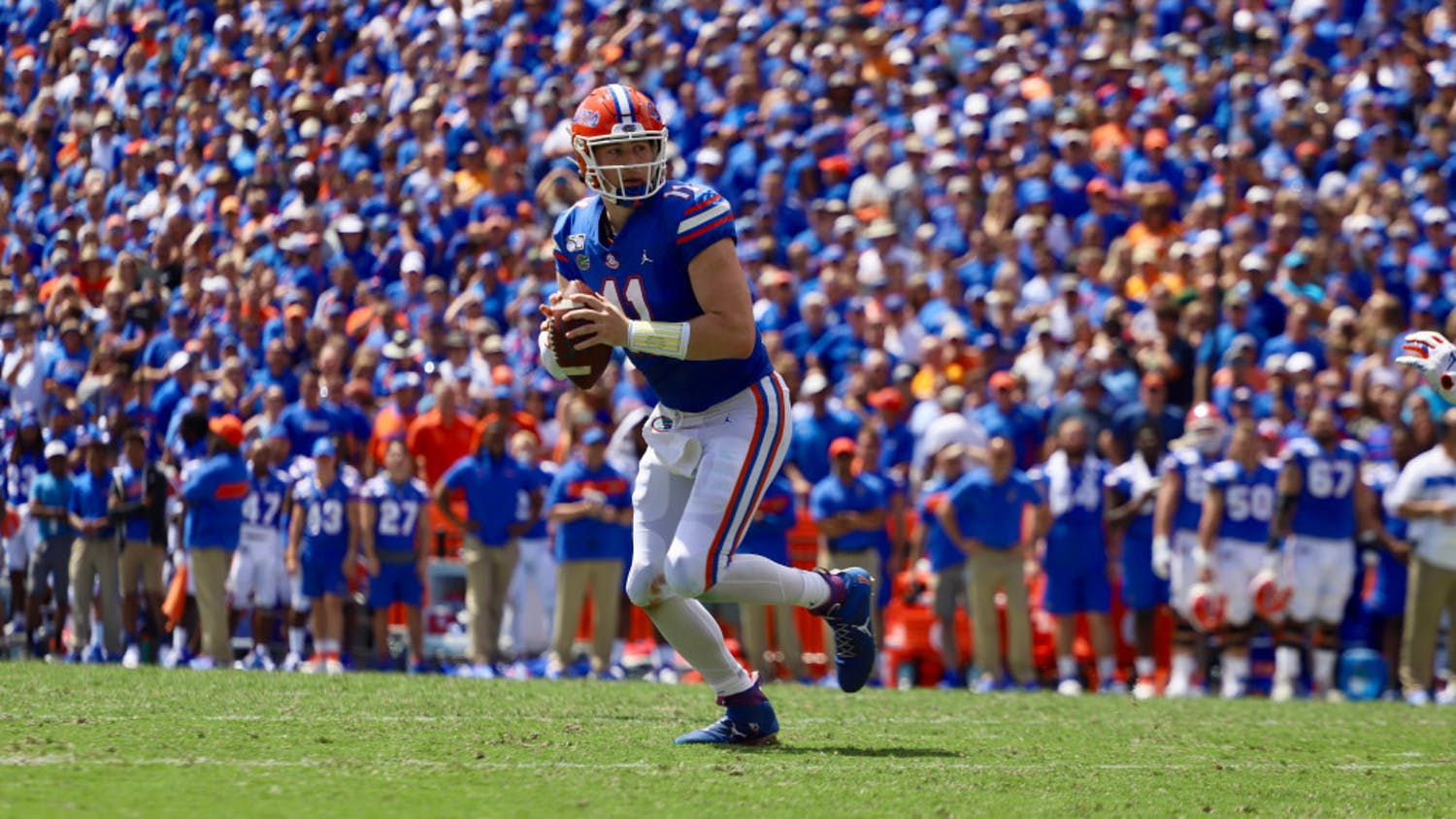 Quarterback Kyle Trask drops back in front of a packed crowdagainst Tennessee last season. This year, most SEC schools will cap their stadium capacities at about 20 to 25 percent.