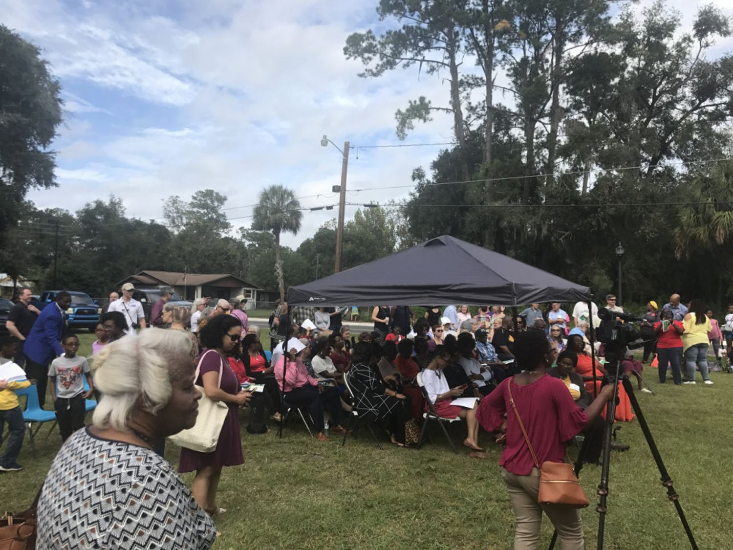 Writer's caption: Gainesville residents gather around the front of the restored Cotton Club Museum and Cultural Center for the ribbon-cutting ceremony.