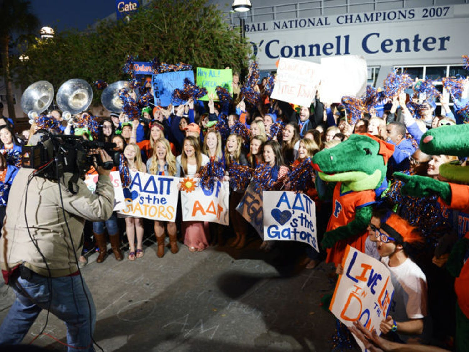 """Students gather in front of the Stephen C. O'Connell Center on Friday morning as part of a live broadcast on NBC's """"Today"""" show in support of the UF men's basketball team."""