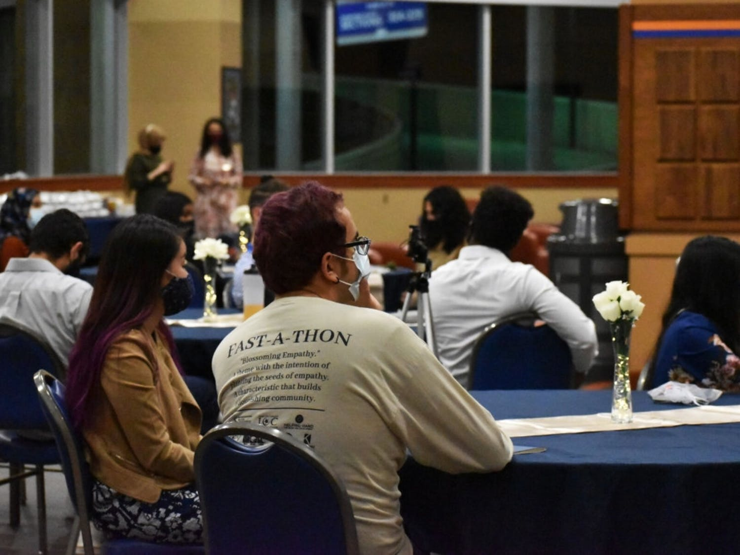 Zachary Raad (center), 20, a UF chemistry and Chinese language senior, is one of about 35 UF students seen attending Linda Soursour's speaking event for Islam Appreciation Month at the Touchdown Terrace on Tuesday, Oct. 27, 2020.