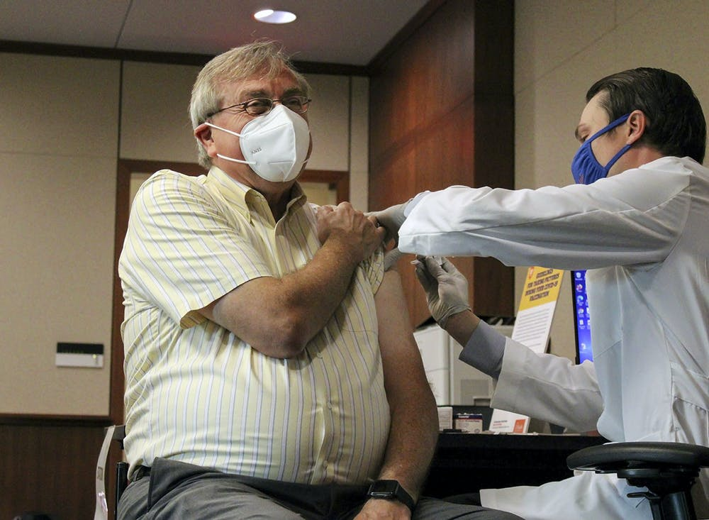 <p>UF President Kent Fuchs receives his first dose of the Pfizer COVID-19 vaccine at UF Health Shands Cancer Hospital Tuesday, Jan. 5, 2021. He said it was painless.</p>