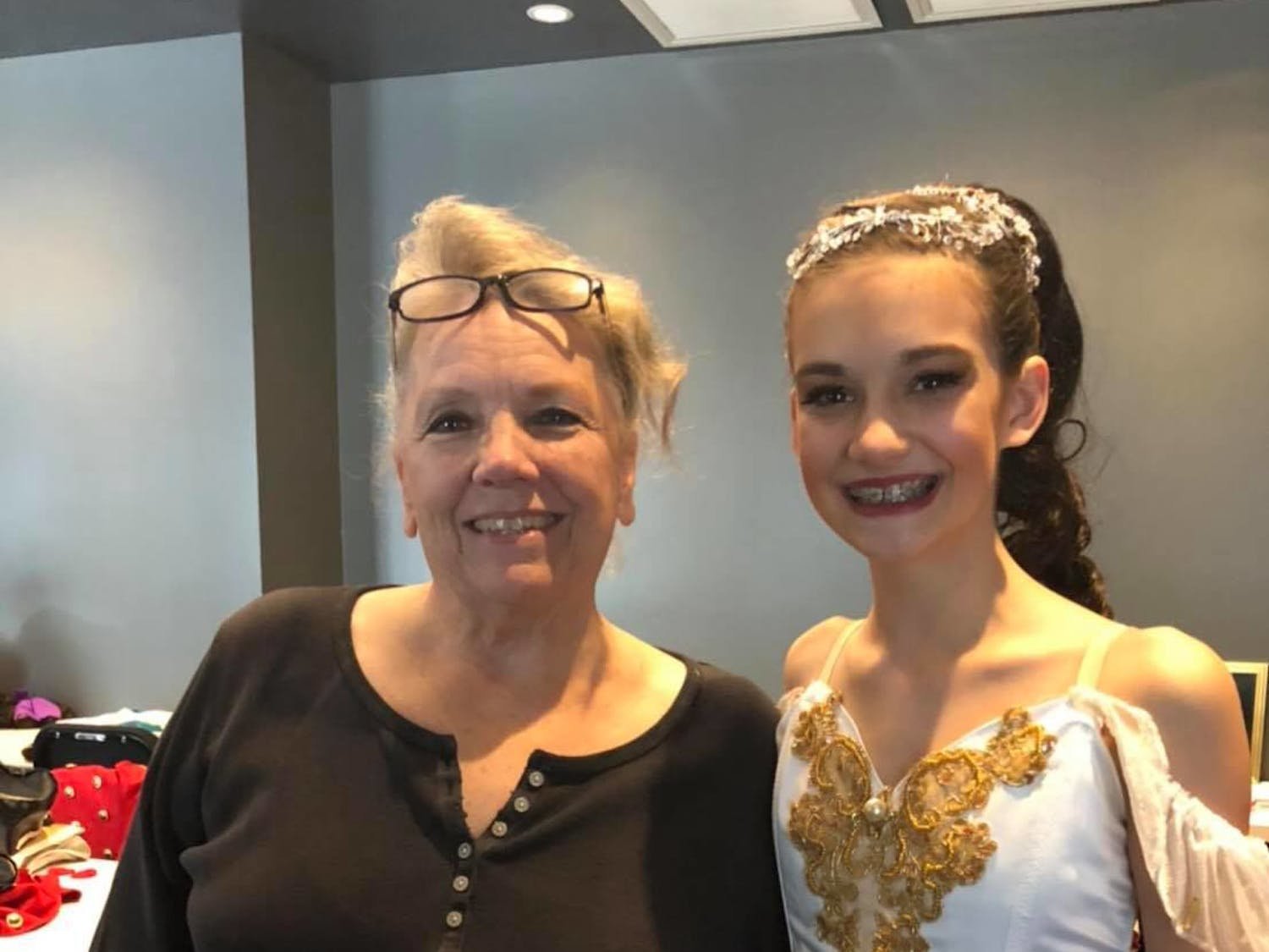 Pofahl Dance Studio co-founder, Kim Tuttle, poses with Kelly Christie's daughter, Mia, after a performance of The Nutcracker.