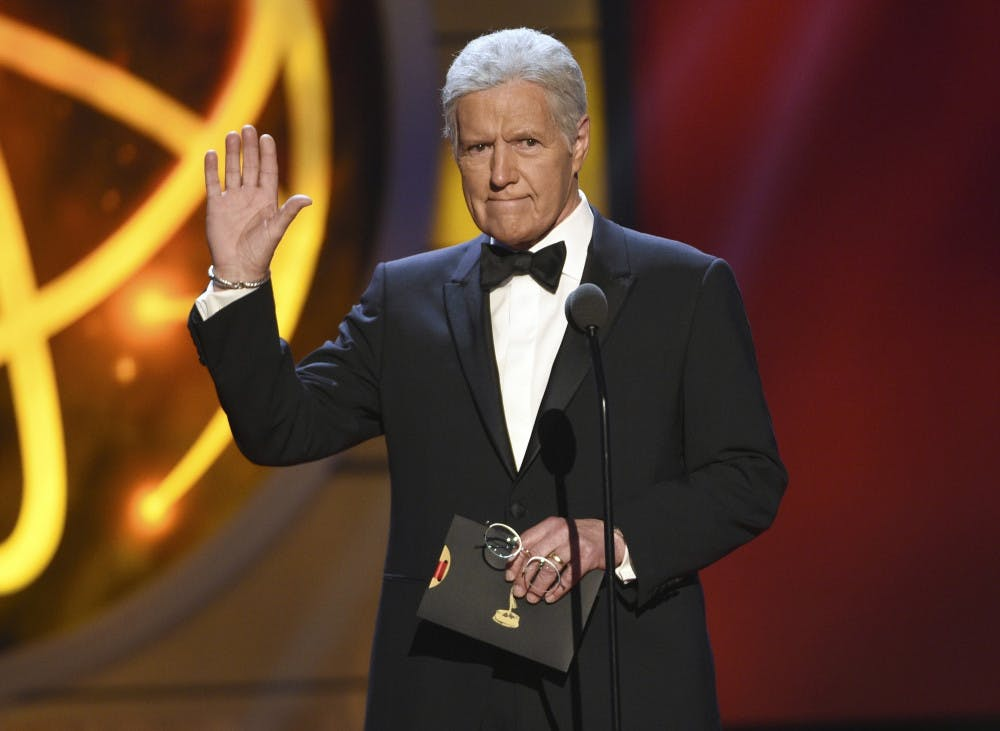 """<p>This May 5, 2019, file photo shows Alex Trebek gestures while presenting an award at the 46th annual Daytime Emmy Awards in Pasadena, Calif. Jeopardy!"""" host Alex Trebek died Sunday, Nov. 8, 2020, after battling pancreatic cancer for nearly two years. Trebek died at home with family and friends surrounding him, """"Jeopardy!"""" studio Sony said in a statement. Trebek presided over the beloved quiz show for more than 30 years.</p>"""
