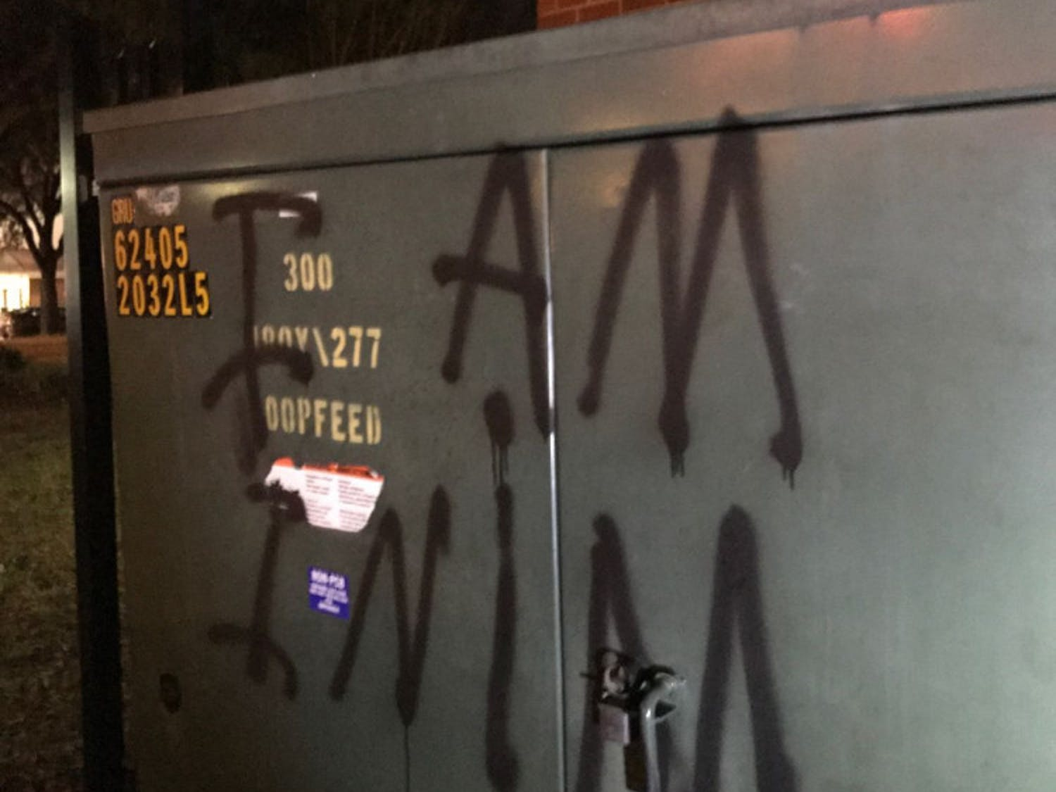 """A UF student spray-painted """"I AM INIM"""" onto the wall of an Alachua County building downtown early Wednesday."""