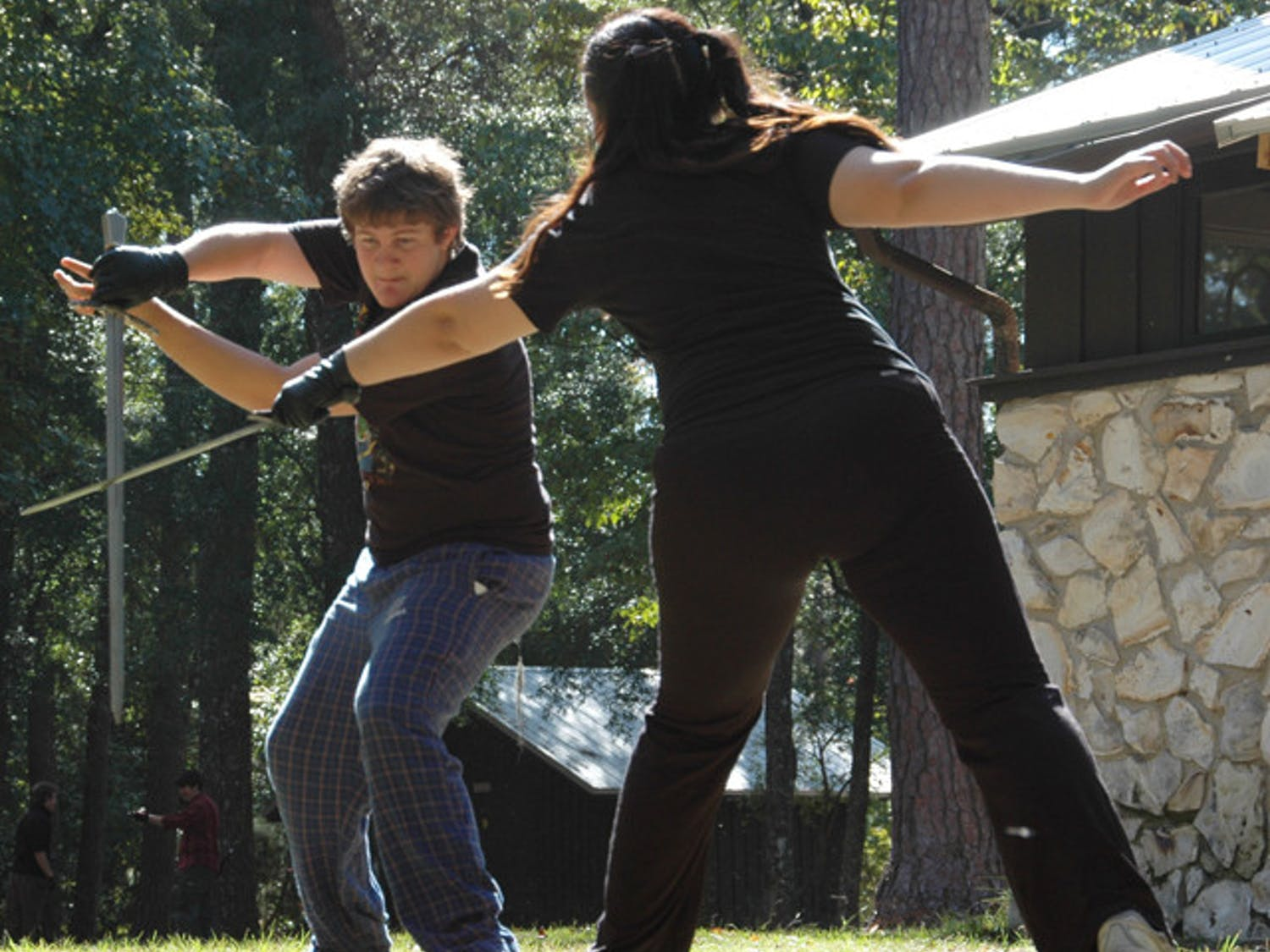 Chet Scott and Shael Millheim practice fighting with swords at O'Leno State Park. Scott and Millheim are part of the Thieves Guild, a group that does most of the performances at the annual Hoggetowne Medieval Faire.