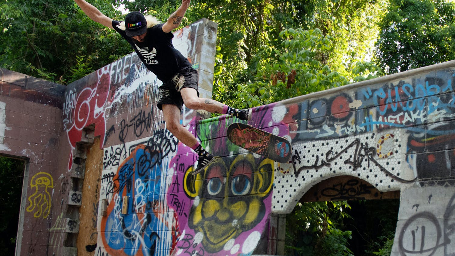 """Josh Ketterer, 29, attempts a skate trick called a """"50/50"""" at the Gentleman's Club, a DIY skate park in Gainesville, Florida on Sunday, May 30, 2021. The skate park was built by skaters on private property and the city has ordered it to be torn down by June 20."""
