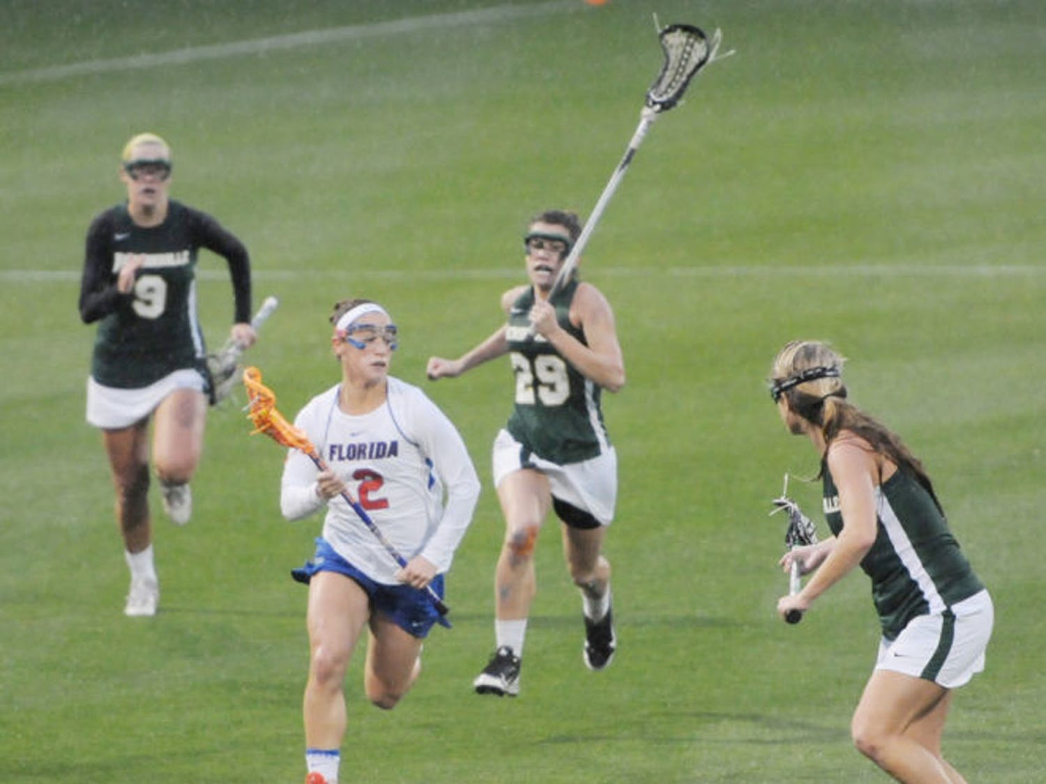 Sammi Burgess (2) drives to the net during Florida's 21-5 win against Jacksonville on Feb. 12 at Donald R. Dizney Stadium. Burgess chose UF over several different schools.