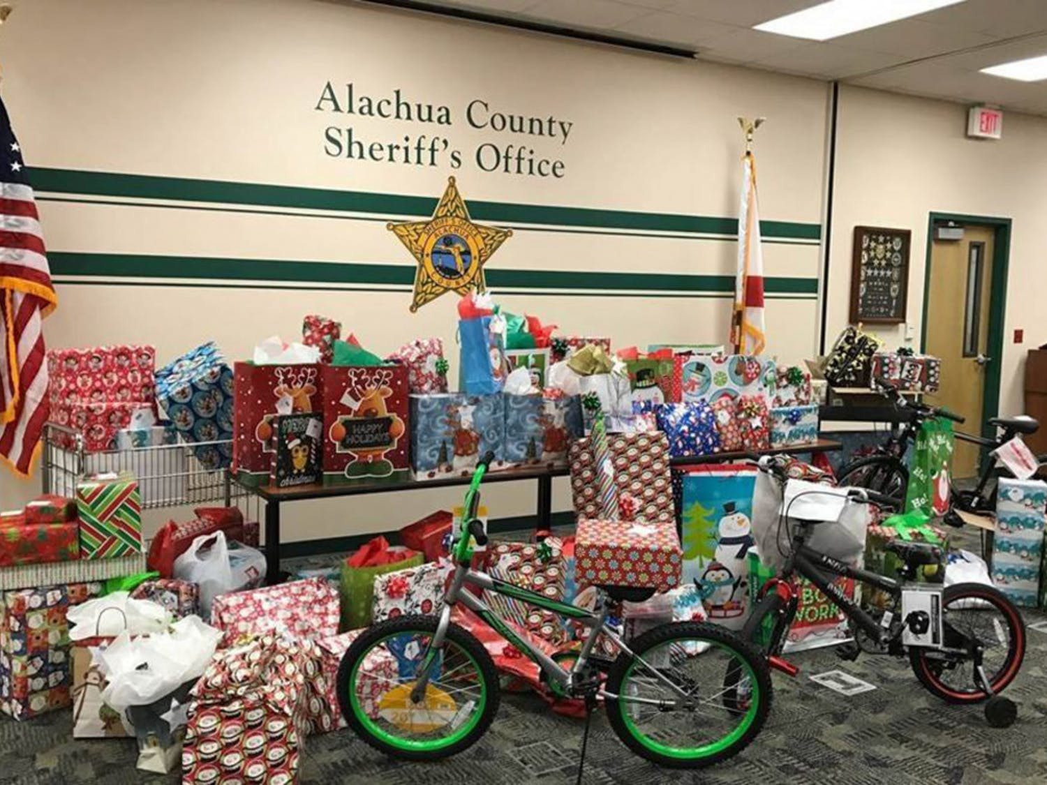 In Gainesville, police officers and sheriff's deputies are embracing the holiday season by donating their time — and toys — to the community. On Friday, Gainesville Police officers will take elementary-school children on a shopping spree to Target as a part of its annual Heroes and Helpers event. Last week, the Alachua County Sheriff's Office handed out gifts to children who had been taken from abusive or neglectful homes.