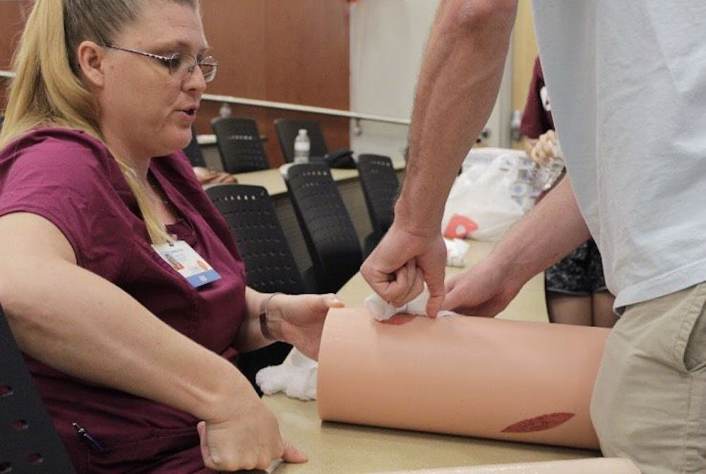 """<div dir=""""auto"""">Students practiced stuffing fake bullet hole wounds with gauze Saturday morning. The two-hour-long educational training taught attendees what to do when someone has life-threatening bleeding in an emergency.&nbsp;</div>"""