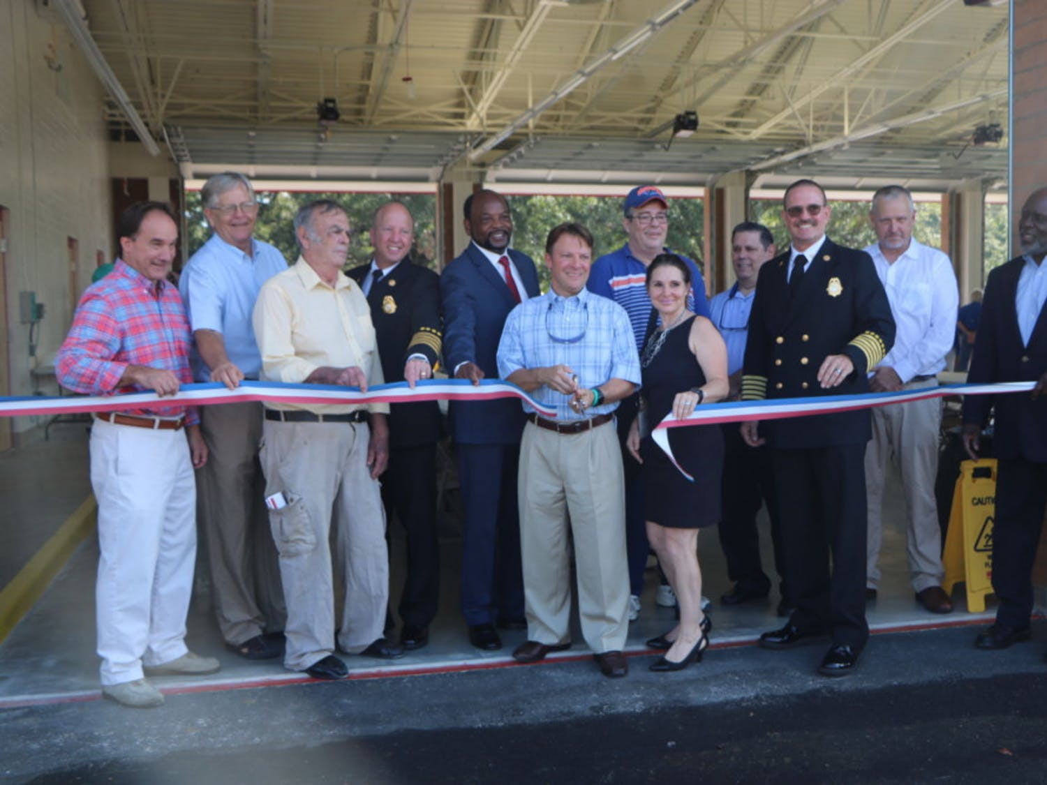 Alachua County Commissioner Ken Cornell cuts the ribbon in front of the new Fire Rescue Station 33, located at 5901 NW 34th Blvd., on Friday. The station will house six ambulances.
