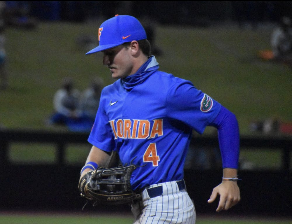<p>Outfielder Jud Fabian jogs off the field March 13 against Jacksonville</p>