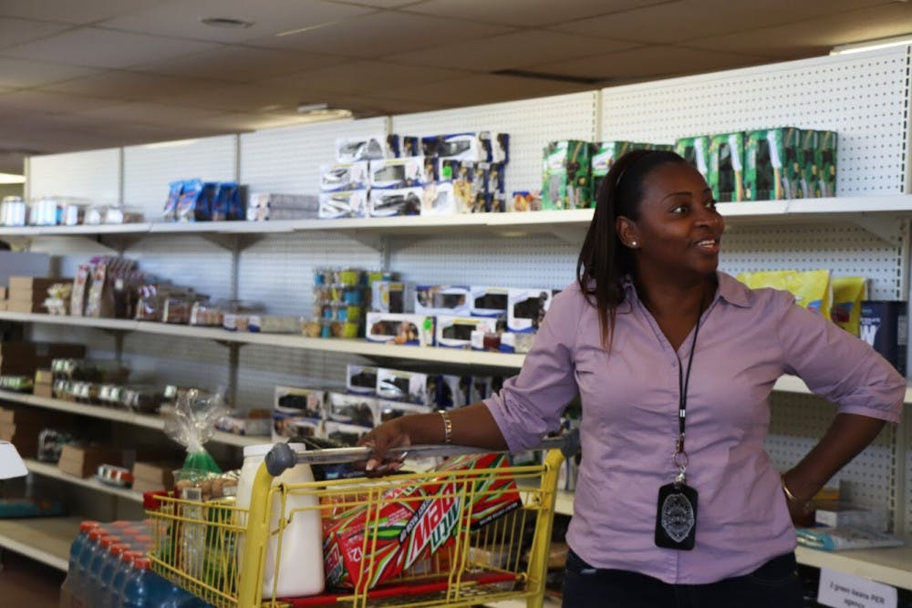 <p><span>Pastor Crystal Griffin stops to talk to a friend while shopping for her ministry on Friday afternoon at the Bread of the Mighty Food Bank. The food bank distributes to five surrounding counties, including Alachua.</span></p>