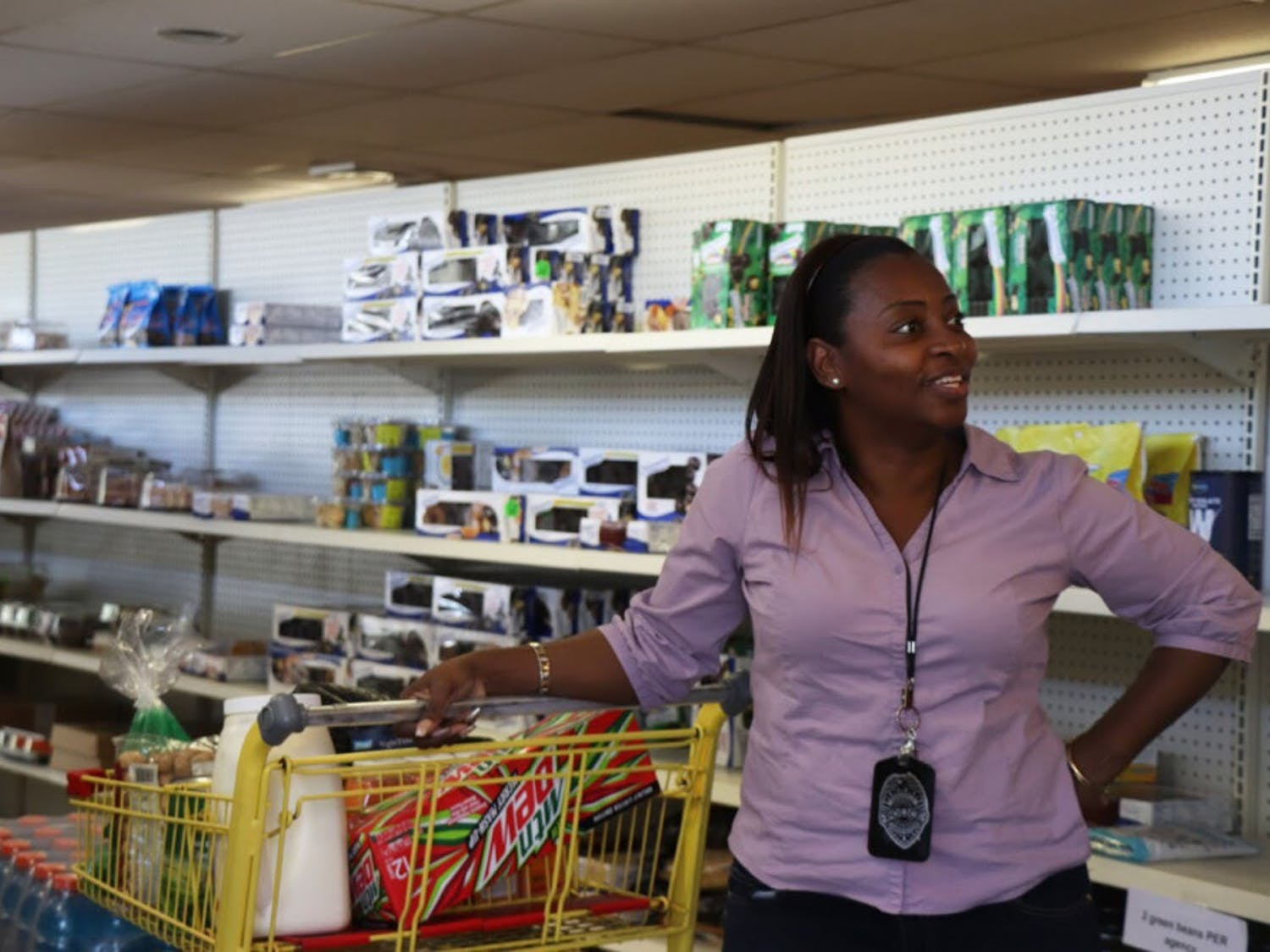Pastor Crystal Griffin stops to talk to a friend while shopping for her ministry on Friday afternoon at the Bread of the Mighty Food Bank. The food bank distributes to five surrounding counties, including Alachua.