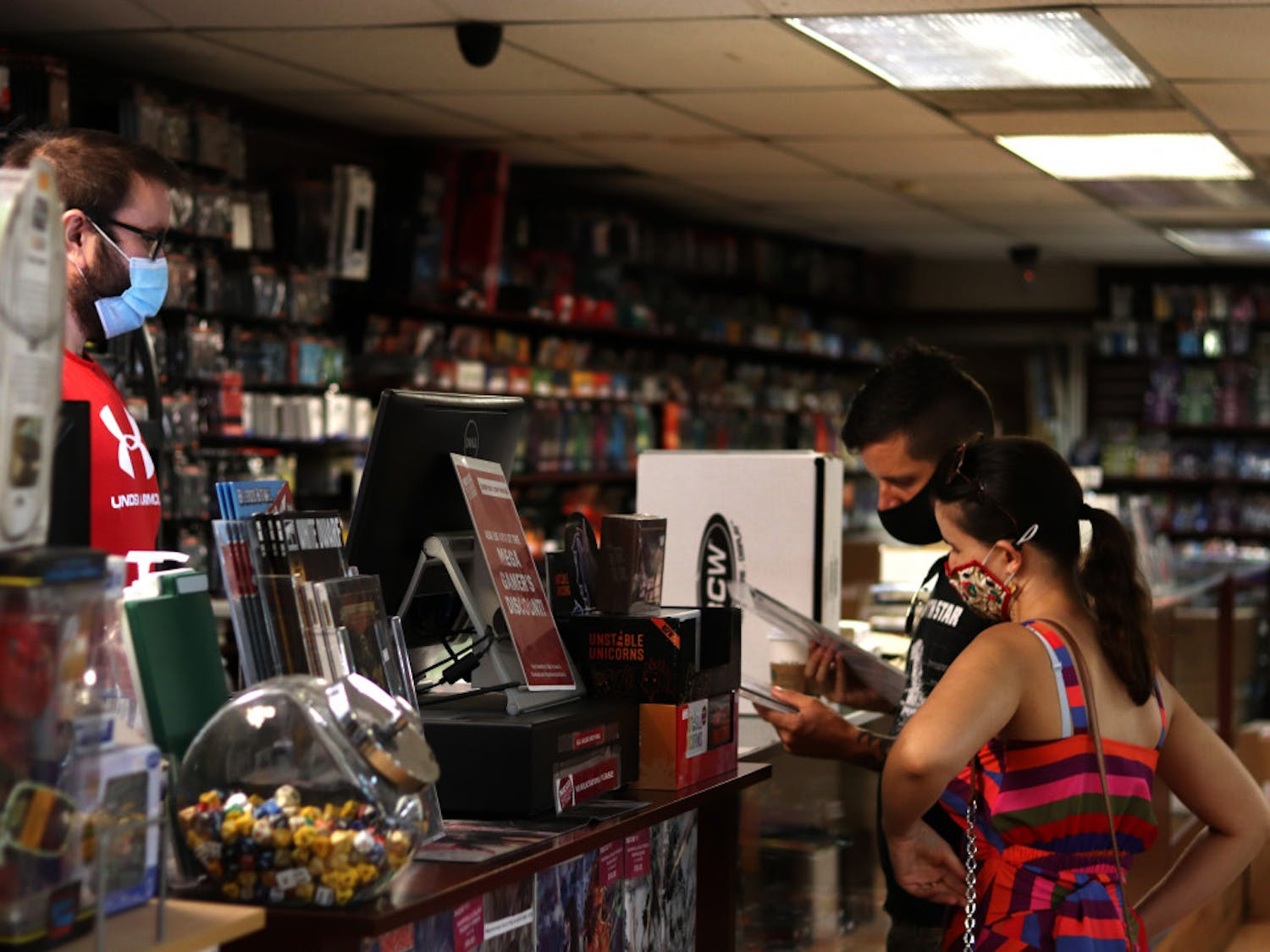 Sarah Desforges and Jared Bienlien check out at Mega Gaming & Comics in Gainesville, Fla., on September 5, 2020.