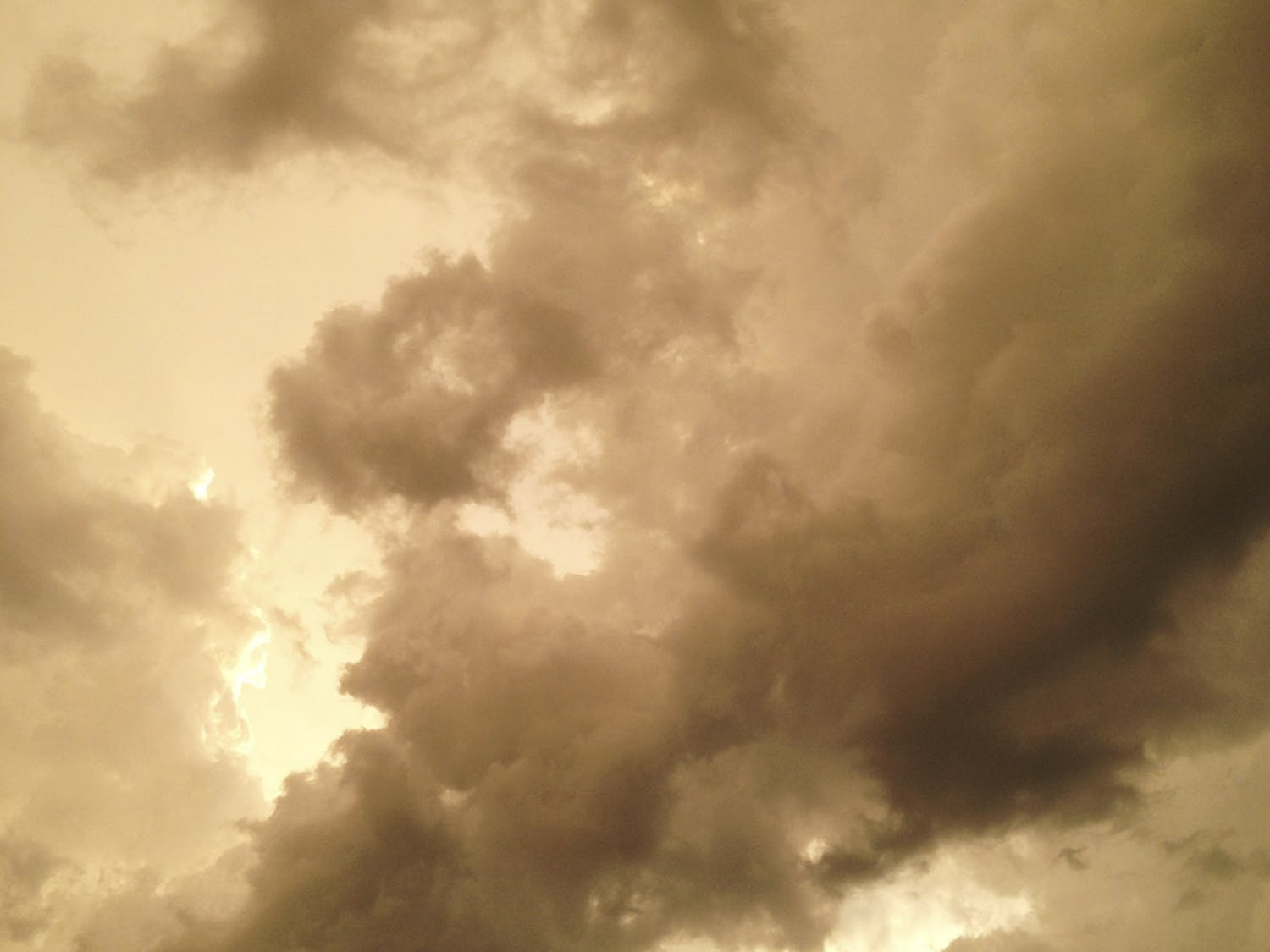 Clouds form a storm above the Museum Walk apartment complex in September.