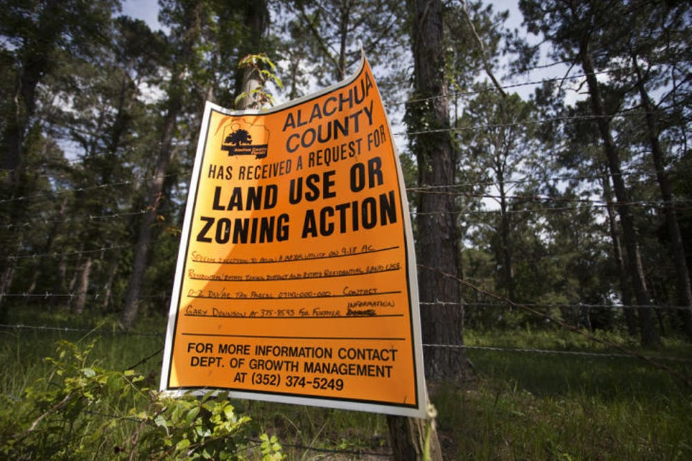 <p>A county sign on Southwest 63rd Avenue informs passers-by of the potential future use for part of Paynes Prairie.</p> <div>&nbsp;</div>