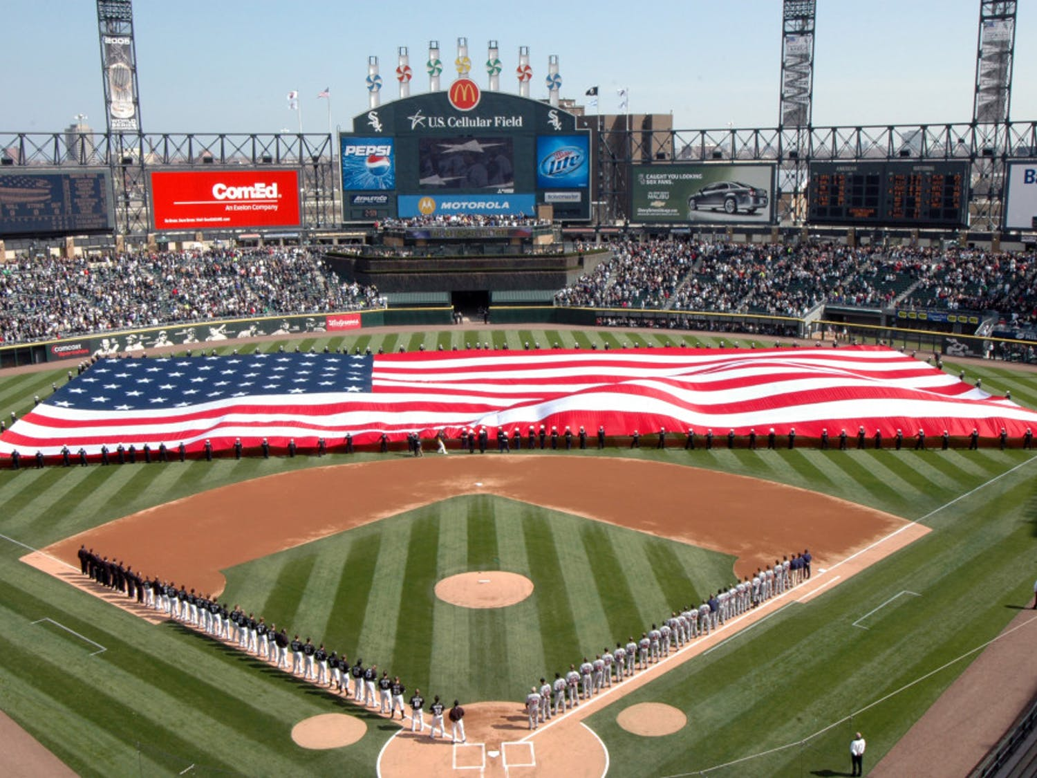 More than 100 U.S. Sailors from Navy Region Midwest, Navy Recruiting Chicago and Naval Station Great Lakes hold an American Flag during the National Anthem at opening day ceremonies for the Chicago White Sox Major League Baseball team at U.S. Cellular Field, Chicago, Ill., April 7, 2008. Great Lakes Sailors have participated in the White Sox opening day for the past six years. (U.S. Navy photo by Scott A. Thornbloom/Released)