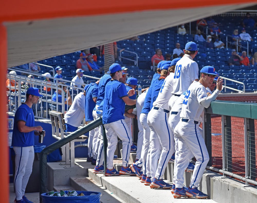 The Florida baseball team stands in the dugout during a game against Jacksonville on March 14, 2021.