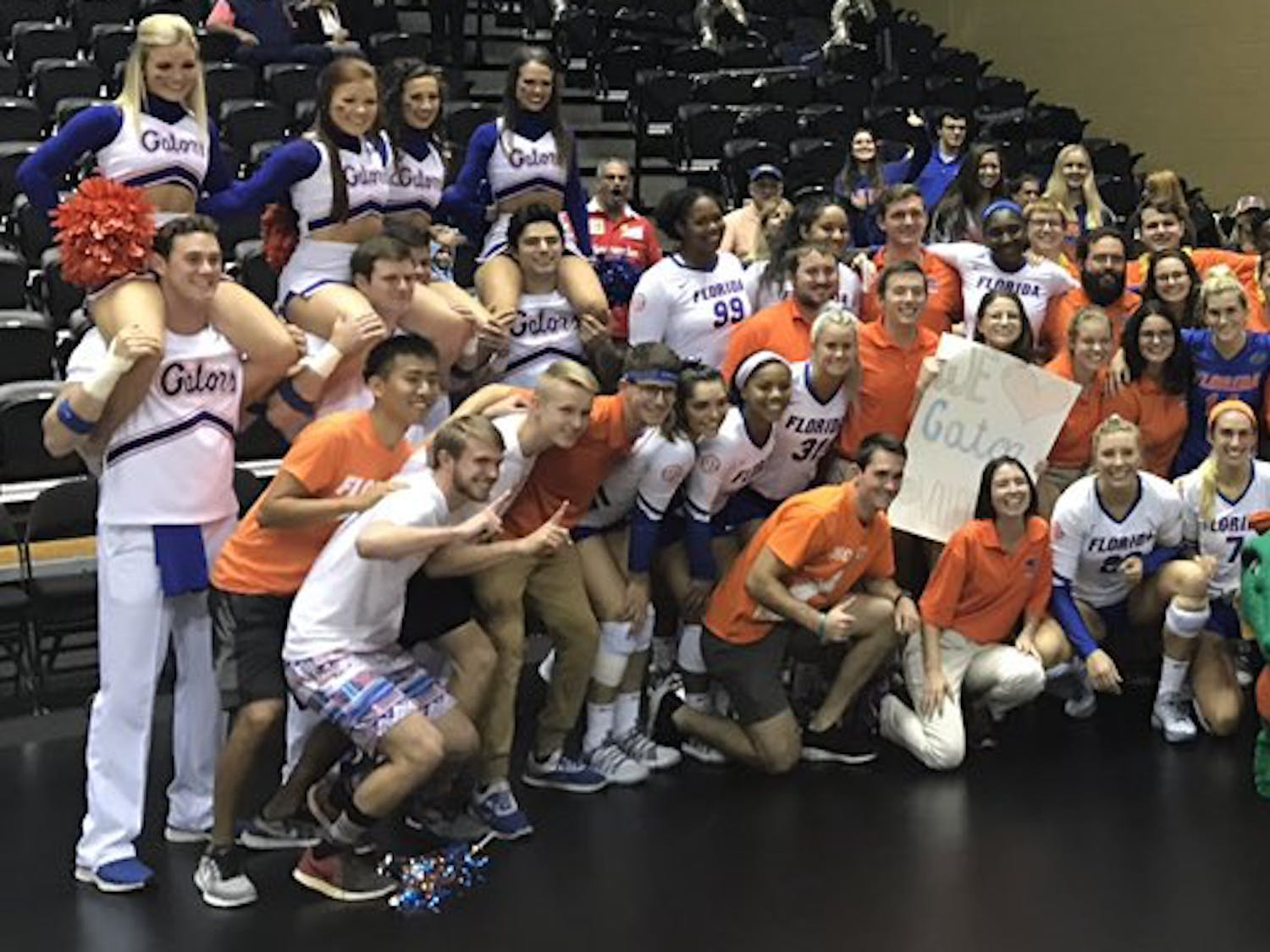 The UF volleyball team celebrates its sweep of FGCU (25-17, 25-13, 25-17) in the second round of the NCAA Tournament with some fans and the Florida band.