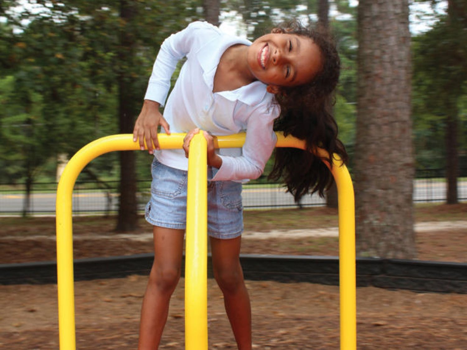 """Auriel Shupack, 7, plays at the Albert """"Ray"""" Massey Westside Park, 1001 NW 34th St., Tuesday afternoon."""