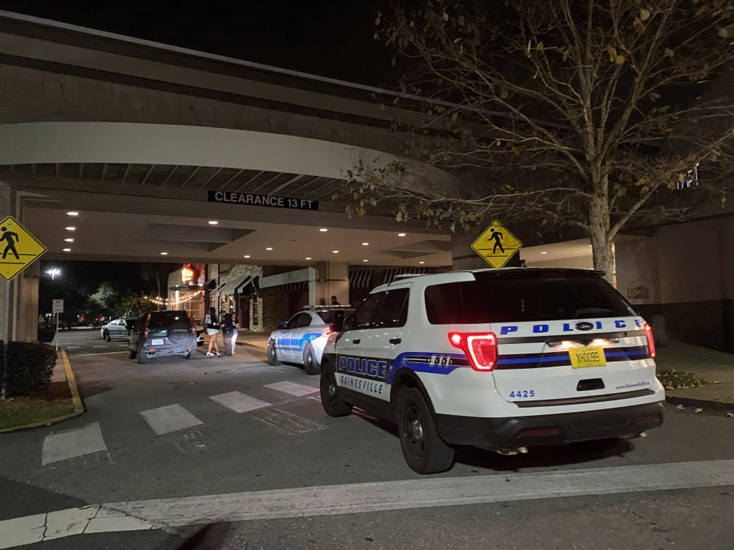 Law enforcement officers interview witnesses in front of Oaks Mall Thursday night after reports of a robbery in front of Pearle Vision, an eye care store located inside the mall.