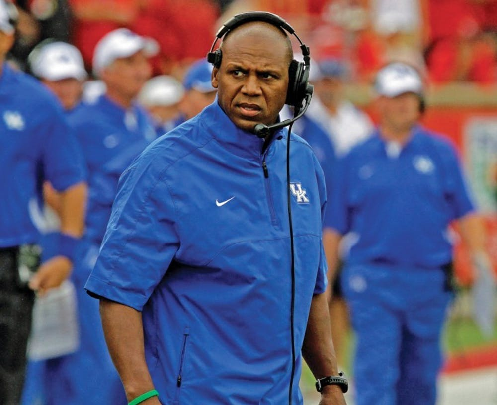 <p>Kentucky coach Joker Phillips reacts after his team failed to make a first down against in their season-opening NCAA college football game against Louisville at Cardinal Stadium in Louisville, Ky., Sunday, Sept. 2, 2012. Louisville won 32-14.</p>