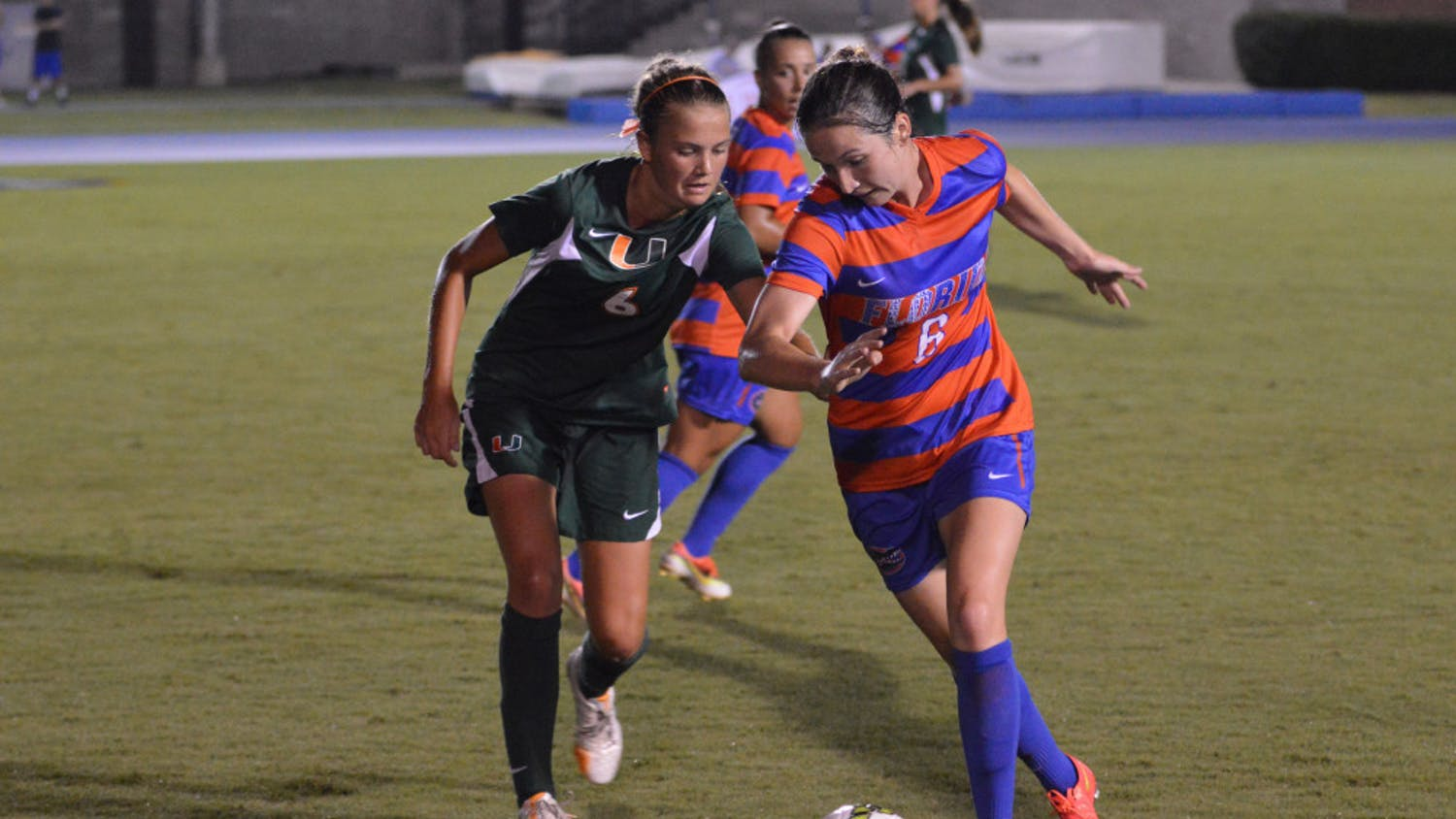 Junior midfielder Lauren Smith dribbles the ball during Florida's 3-0 win against Miami on August 22, 2014, at James G. Pressly Stadium.