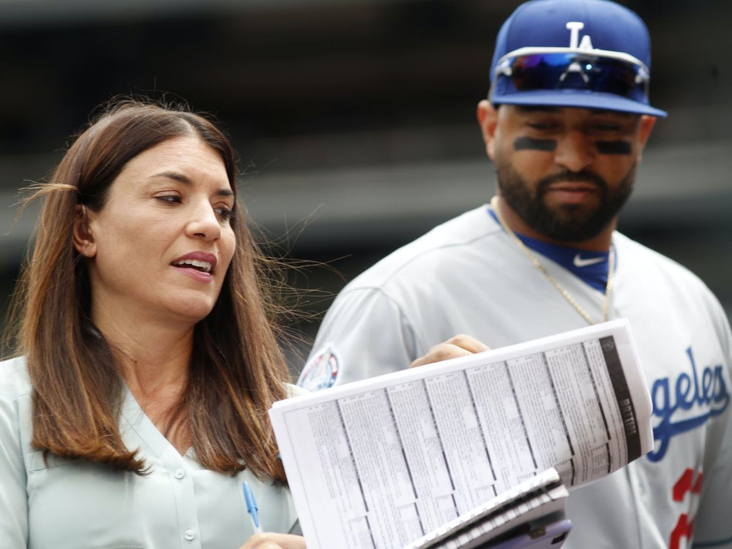 Alanna Rizzo, left, delivers a report before a 2018 game between the Los Angeles Dodgers and Colorado Rockies in Denver as then-Dodgers left fielder Matt Kemp looks on. Rizzo on Tuesday night will be part of Major League Baseball's first all-female broadcasting crew. [ DAVID ZALUBOWSKI | AP ]