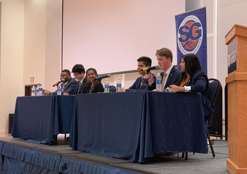 <p>More than 200 students, watched as the Impact candidates — Michael Murphy for Student Body president, Sarah Abraham for Student Body vice president and Santiago Gutierrez for Student Body treasurer — and Inspire Party candidates — Chou, Gouthami Gadamsetty for Student Body vice president and Mackintosh Joachim for student body treasurer — debated.</p>