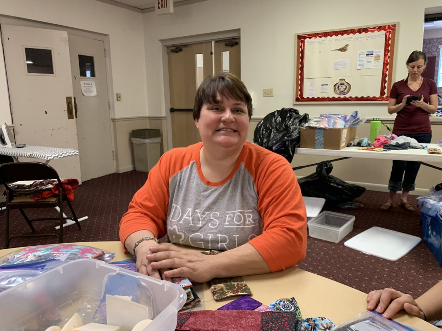 Michelle Belanger, co-leader of Days for Girls Alachua, preps shields and panty liners into Ziploc bags to be ready for kit assembly.