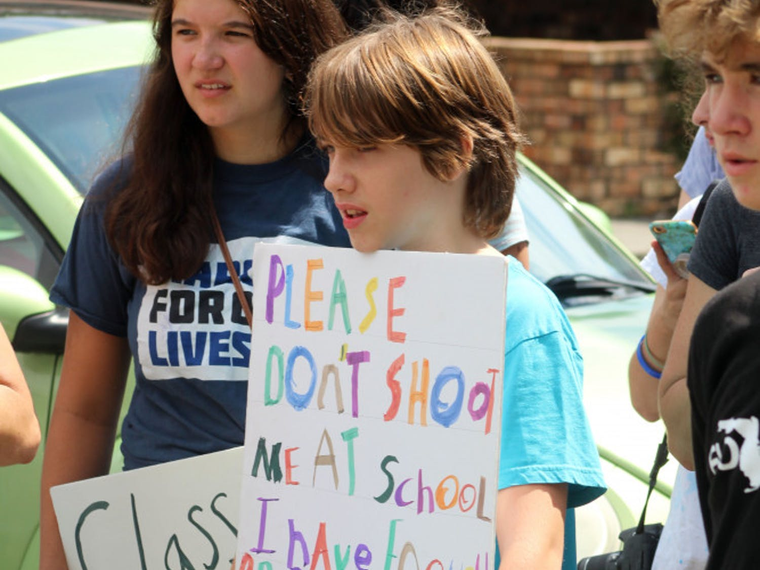 """Children, students, and Gainesville residents rallied alongside survivors of the Parkland school shooting on July 26, 2018 at Congressman Ted Yoho's office. The event was part of the MSD """"Road to Change"""" tour in which students are calling for their local representatives to """"say no"""" to the NRA."""