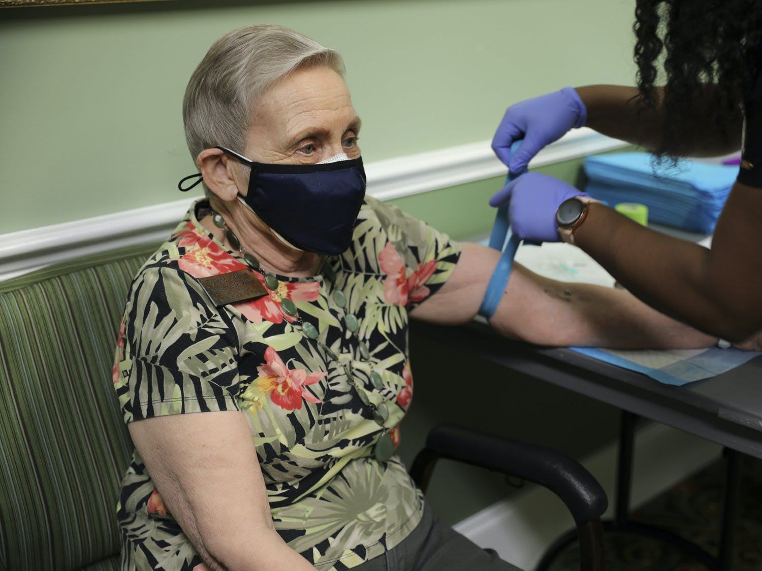 Valerie Griffith, a Founders Club member of Oak Hammock at the University of Florida, participates in the CITRUS Study as a nurse puts a tourniquet on her arm on Wednesday, June 9, 2021.