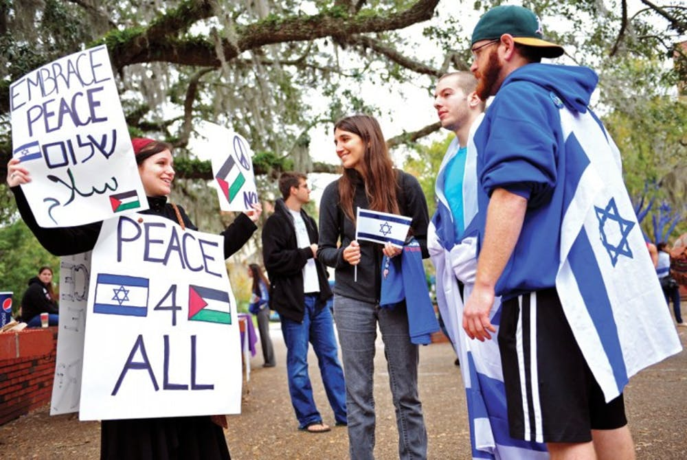 """<p>Jewish studies and political science student Jaimie Krass, 21, came independently to Turlington Plaza Thursday to promote peace during a rally split between support of Israel and Palestine. """"Both sides are so preoccupied with pointing fingers,"""" Krass said. """"We've forgotten to come together for a common goal: peace.""""</p>"""