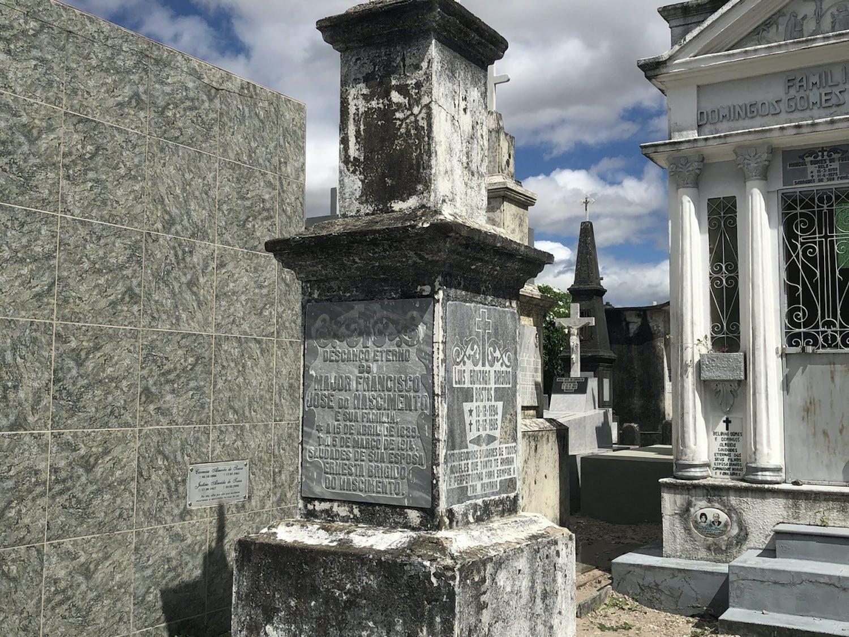 """The tomb of Francisco José do Nascimento, nicknamed """"Sea Dragon,"""" caked in dirt when UF history graduate student Licinio Nunes de Miranda found it in July. [Courtesy of Licinio Nunes de Miranda]"""