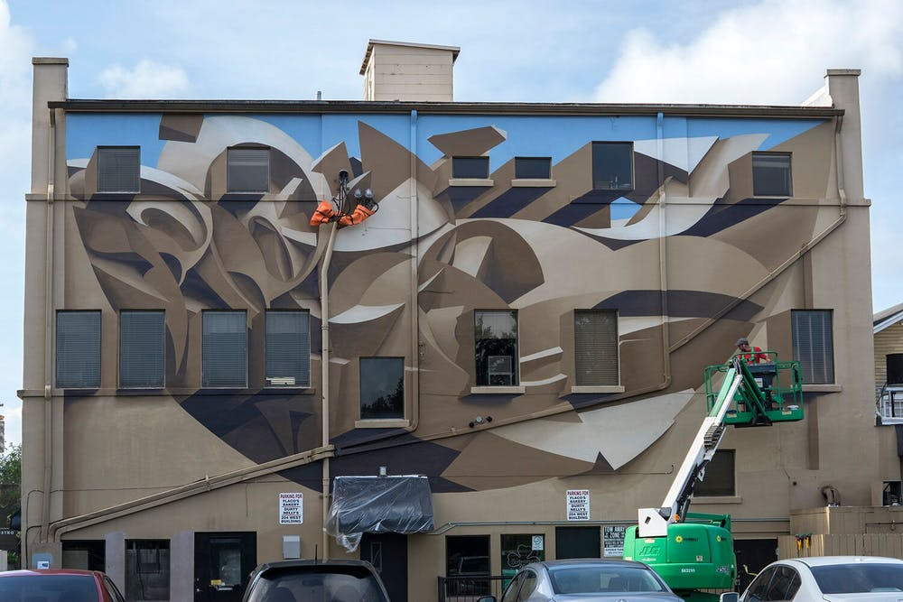 <p>Muralist Manuel Di Rita finished the 3D-painted mural with acrylics Wednesday. The optical illusion mural took a week to complete.</p>