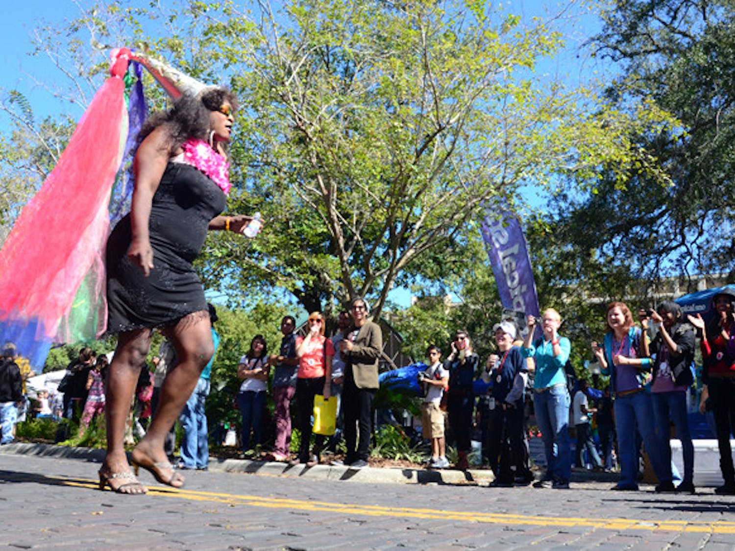 Connell Howell, known as Champagne, struts down Southeast First Street during the Gainesville Pride Parade on Saturday.
