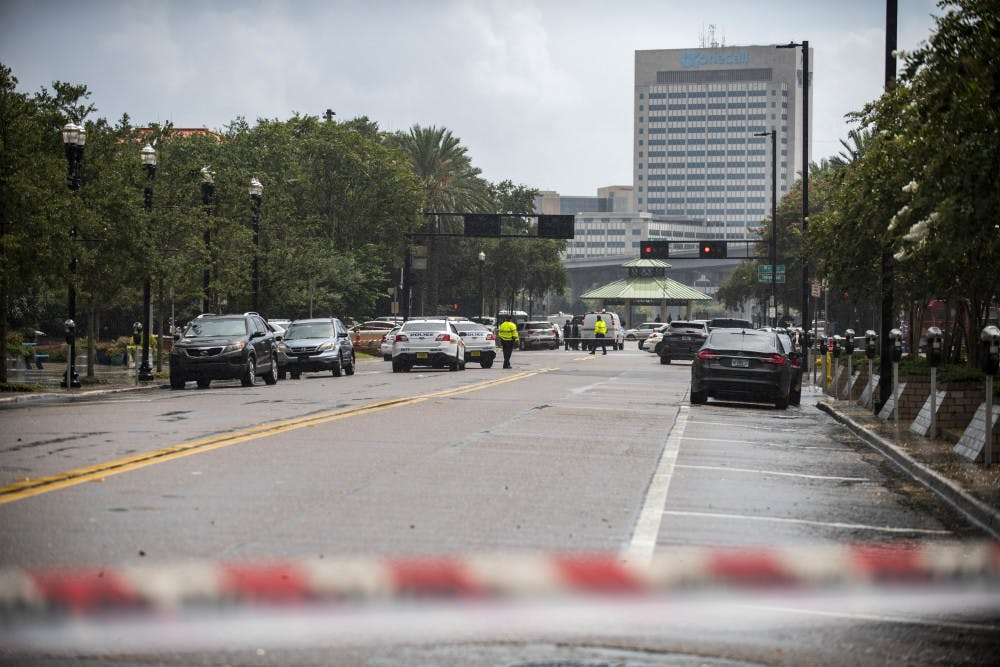 <p>Police barricade a street near the Jacksonville Landing in Jacksonville, Fla., Sunday, Aug. 26, 2018. Florida authorities are reporting multiple fatalities after a mass shooting at the riverfront mall in Jacksonville that was hosting a video game tournament. (AP Photo/Laura Heald)</p>