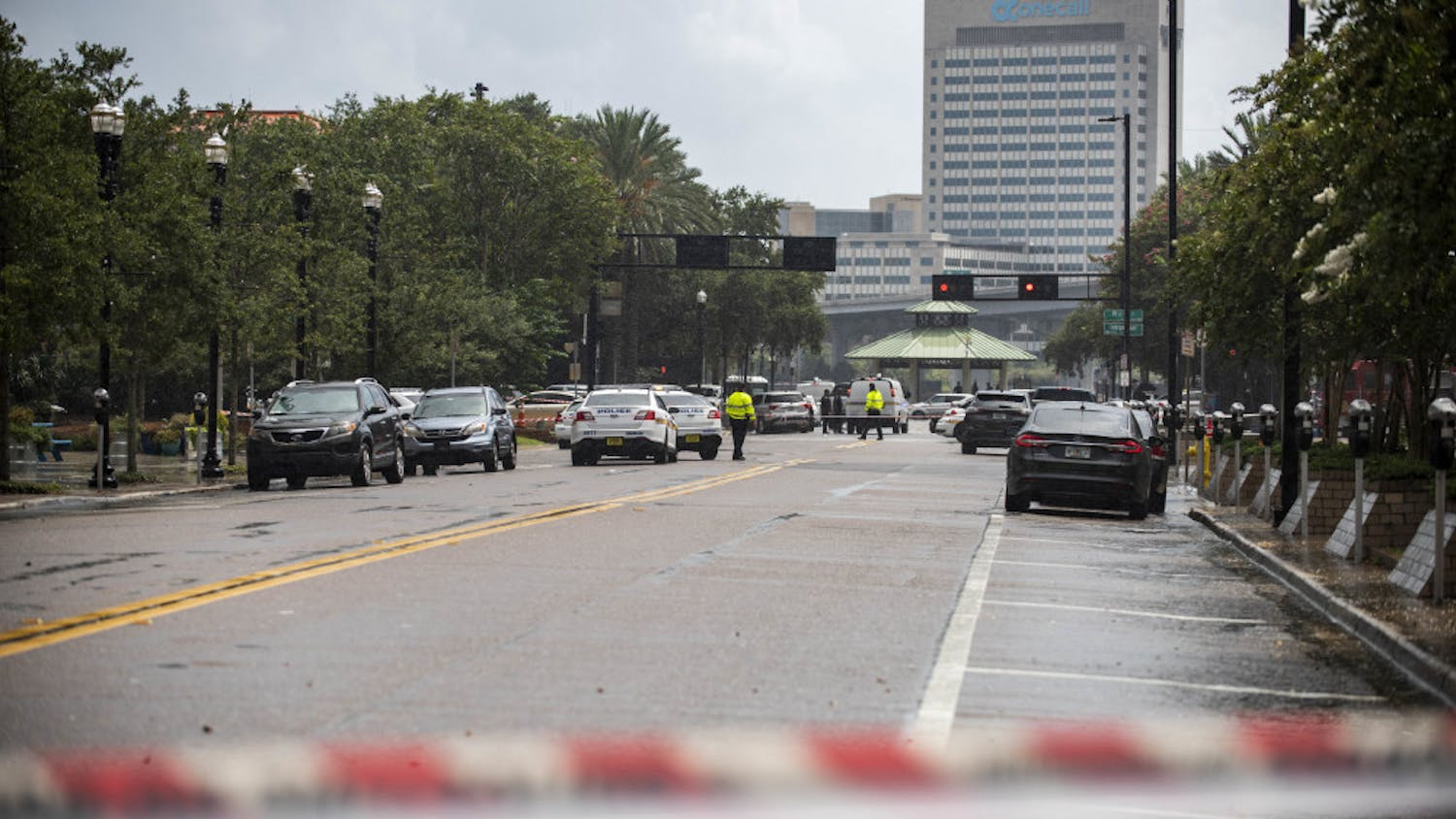 Police barricade a street near the Jacksonville Landing in Jacksonville, Fla., Sunday, Aug. 26, 2018. Florida authorities are reporting multiple fatalities after a mass shooting at the riverfront mall in Jacksonville that was hosting a video game tournament. (AP Photo/Laura Heald)