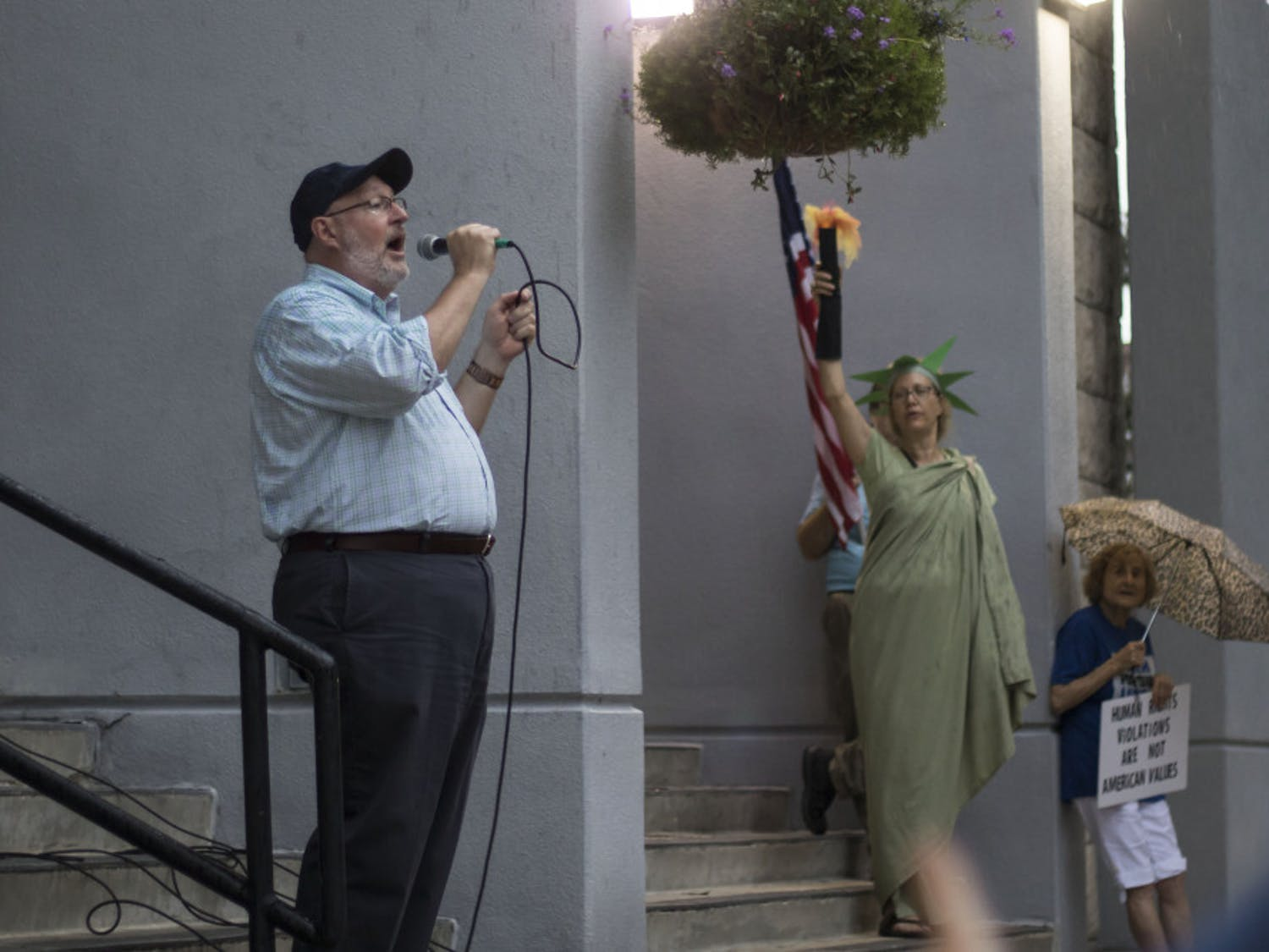 At a recent Gainesville protest, City Commissioner Harvey Ward asked the crowd to support the city joining the lawsuit.