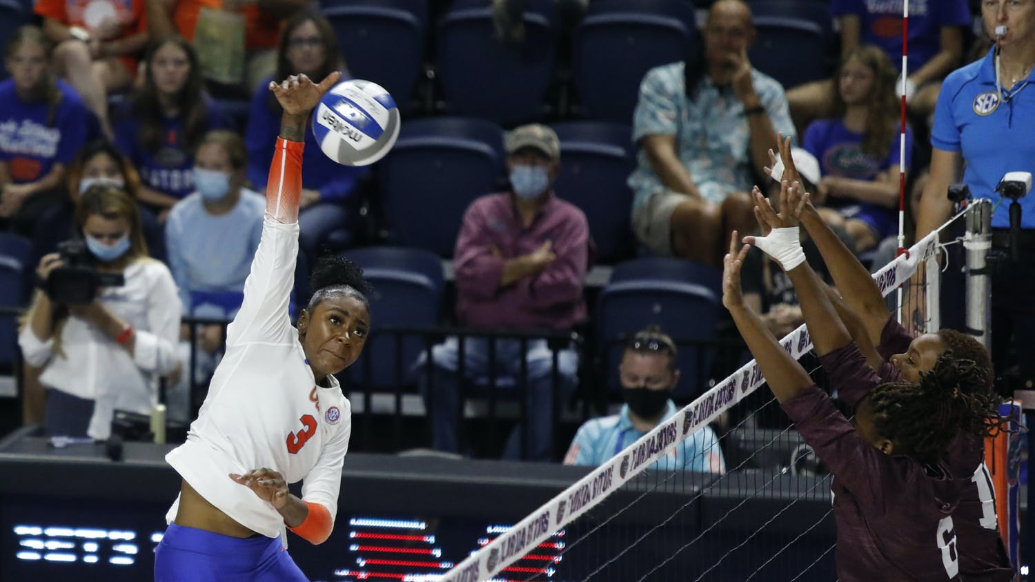 Florida outside hitter T'ara Ceasar spikes a ball toward the Mississippi State defense on Friday night in the O'Connell Center.