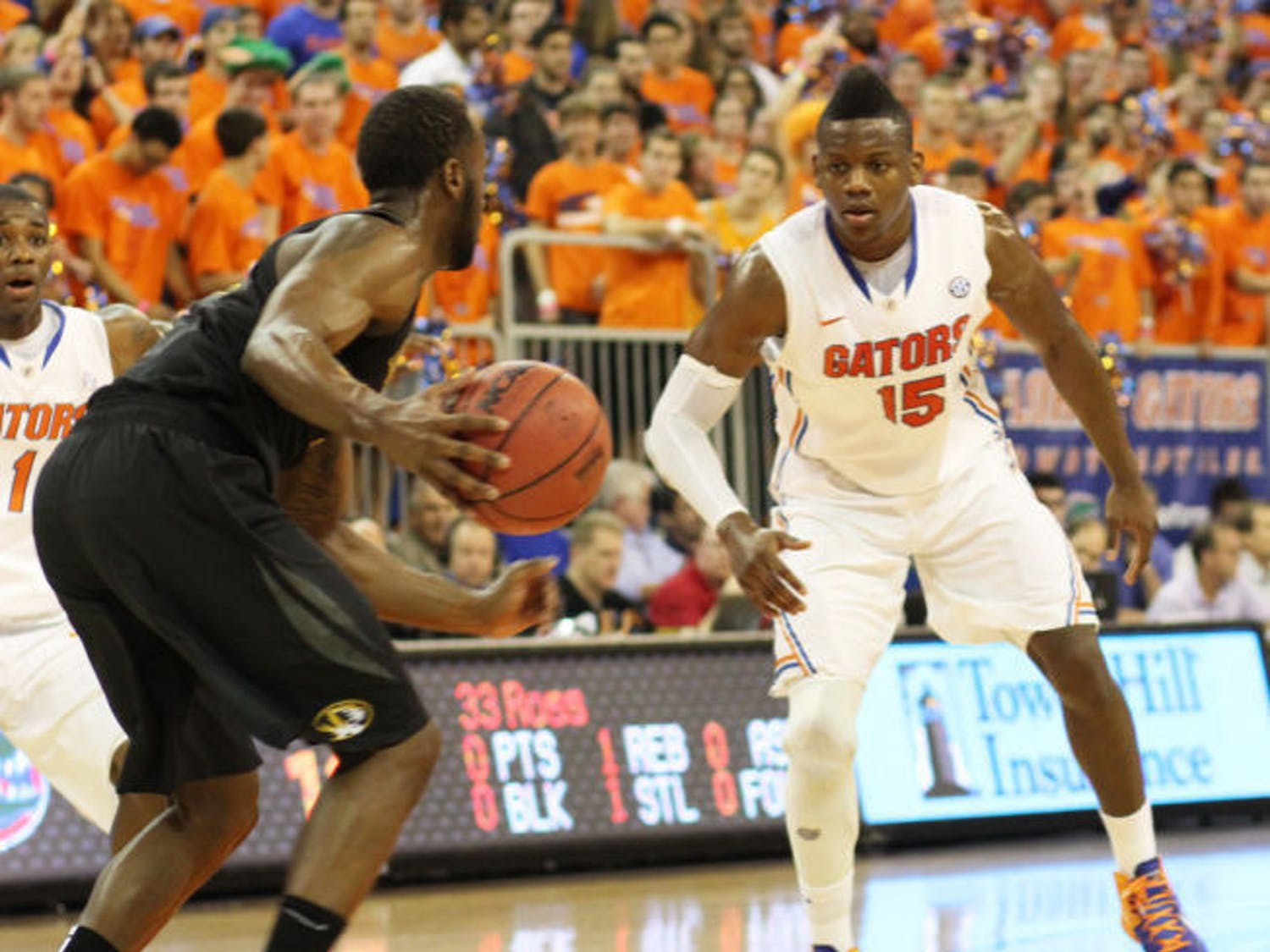 Junior forward Will Yeguete (15) plays defense during Florida's 83-52 victory against Missouri on Saturday in the O'Connell Center. Yeguete will miss 4-6 weeks with bone chips in his right knee.