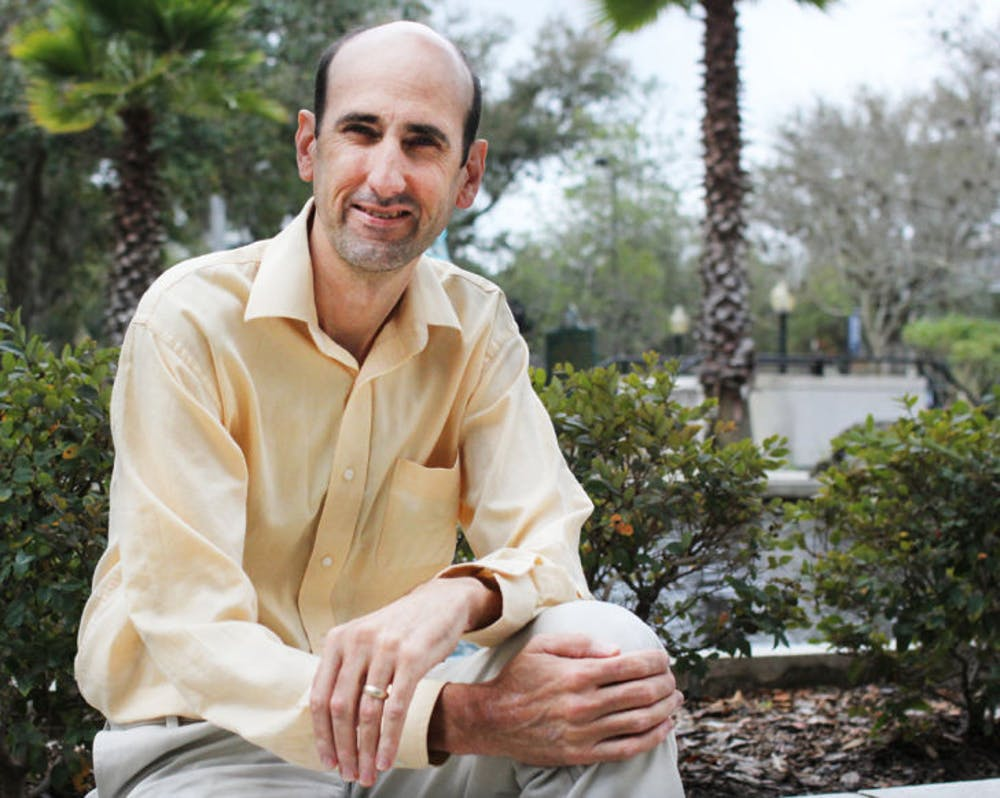 <p>Current District 4 Gainesville City Commissioner Randy Wells sits on a ledge at City Hall on Feb. 12. Wells is the current chairman of the Equal Opportunity Committee and Metropolitan Transportation Planning Organization.</p>