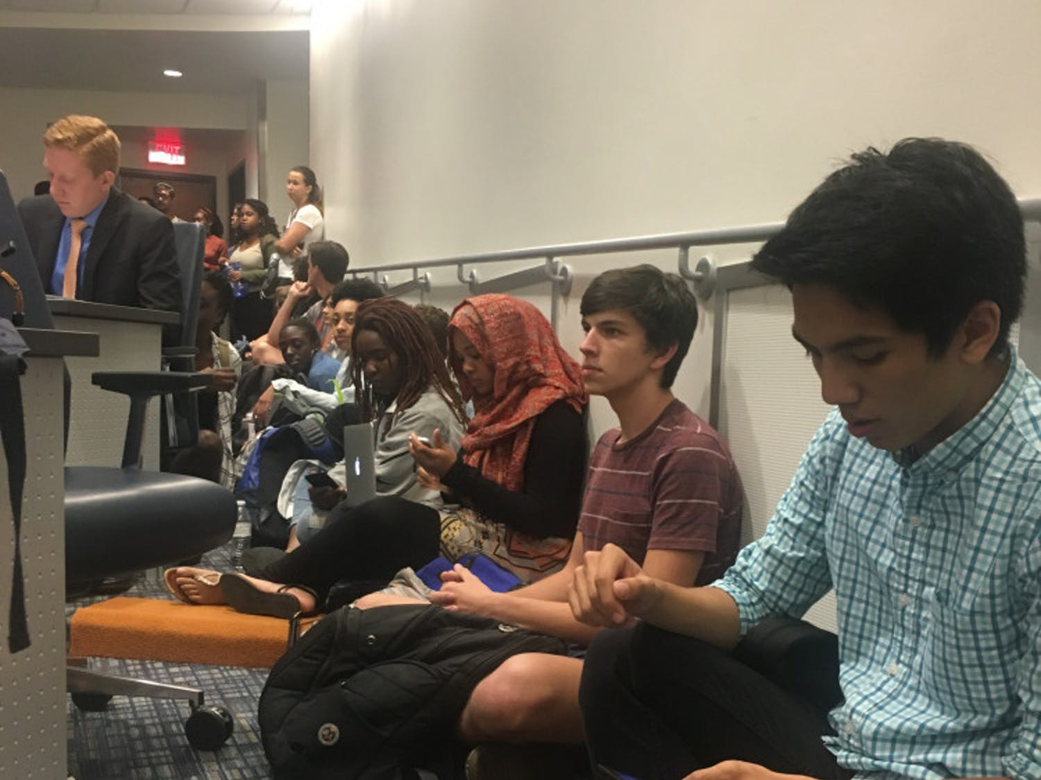 Students sit in at the Student Government Student Senate meeting on Tuesday. Although 43 students signed up for public debate, more students filled the chambers to object senators' silence regarding the lack of funding for the Counseling & Wellness Center and Richard Spencer's visit to UF on Thursday.